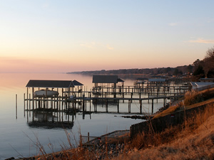 Sunset along the bank of the James River looking toward Hilton Village in Newport News, VA